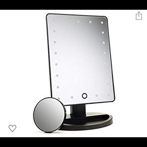 Light up makeup rotating mirror with magnification